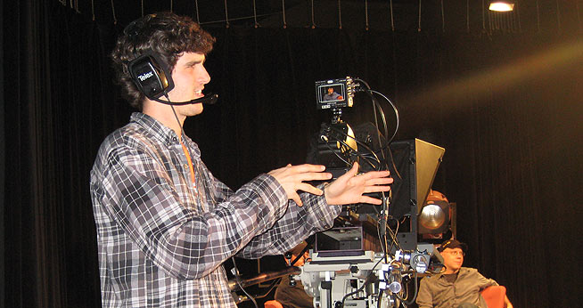 SOC Boy with headset in studio