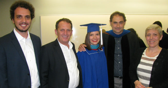 Commencement reception with Prof. Bernhofen, IE graduate Dita Dobranja, and her family