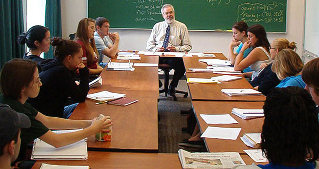 SOC Comm Studies Joe Campbell and students around table