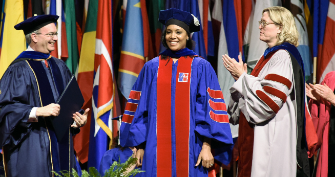PhD Alumna Tiana Jackson receives her diploma at the 2016 SIS commencement ceremony