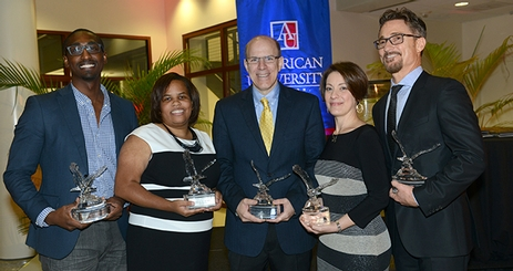 The 2014 alumni award winners hold their eagle trophies.