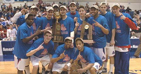 Men's Basketball Team with trophy, photo by Jeff Watts.