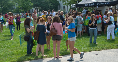 Students mingle on the quad talking to Orientation Leaders.