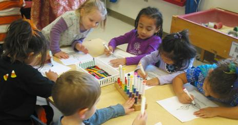 Children coloring at the CDC
