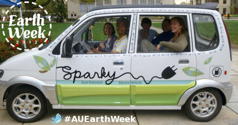 Environmental Science students and staff pose in electric vehicle Sparky during Earth Week 2011