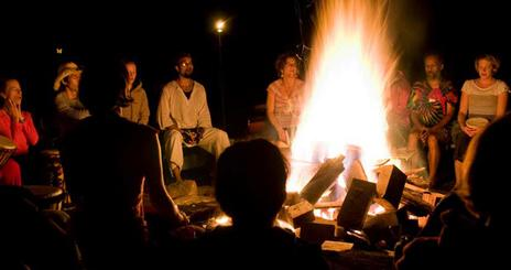 Students around a campfire.