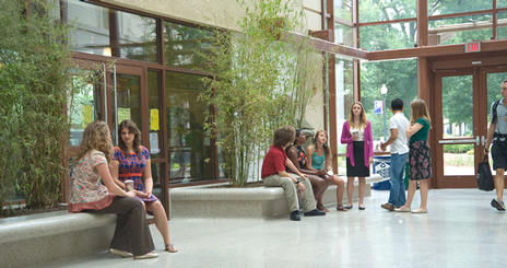 School of International Service undergraduates sit in the Atrium of the SIS Building.