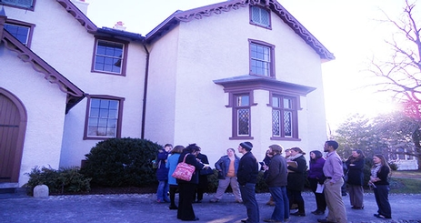 Public History students and faculty taking a tour of President Lincoln's Cottage at the Soldier's Home.