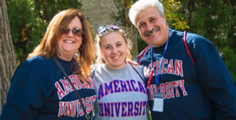 Student with her parents at All American Weekend.
