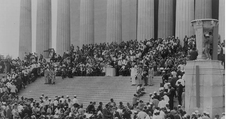 People on the steps of the Lincoln Memorial during the MLK March on Washington.