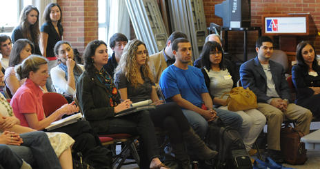 Graduate students attending a lecture.
