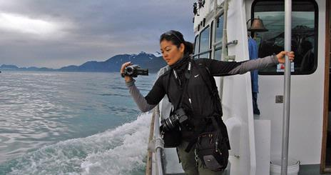 Arlene Agulto, one of twelve students who traveled to Alaska for <em>Classroom in the Wild: Extreme HD</em>, films whales.