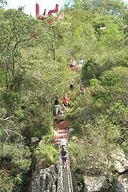 Students crossing the Kitengela suspension bridge