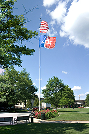 American and AU flags flying on flagpole on quad on AU's main campus