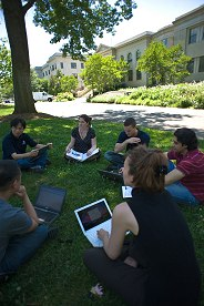 Students work on their laptops on the Quad