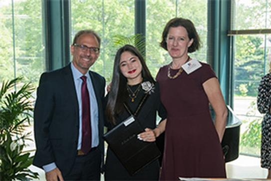 Alumna Sophia Vos with Dan Myers and Mary Clark