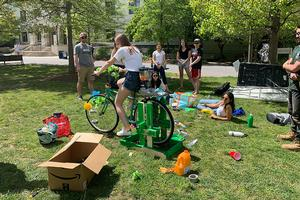 Junior Sarah Gruesser tests out a newly built smoothie bike