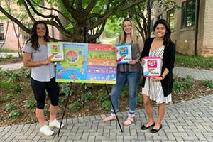Three students with the Eat Smart banner
