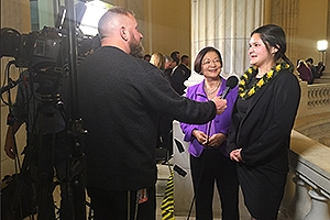 Sierra Schmitz gives a TV interview at the State of the Union address.