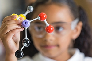 Girl with science model