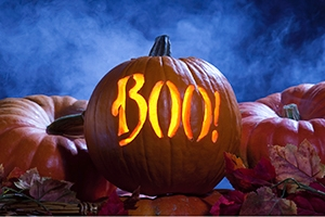 A jack-o-lantern glows with the word