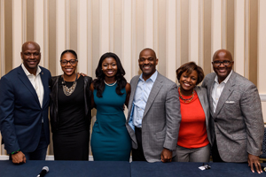 Genever Oppong (center) with ELC coca-cola executives.