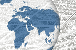 Newsprint beside half a globe