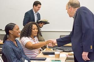 Dr. Robert Stokes shakes hands with online students at the inaugural Online Graduate Students Immersion Experience