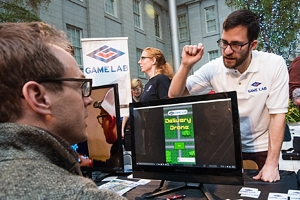 Game Design MA student Cole Wramplemeyer talks with other game professionals and enthusiasts at Indie Arcade.