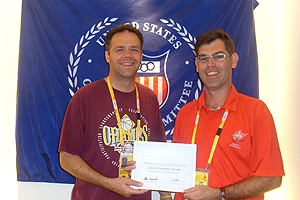 J.C. Brooke, '95, receives a certificate of appreciation for his work and support of the 2008 U.S. Olympic Team during the Games of the XXIX Olympiad in Beijing, China.