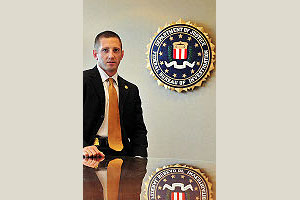 FBI Special Agent Rick Evanchec, SPA/BA '02.  Photo by: Jennifer Combs, WFO Field Photographer