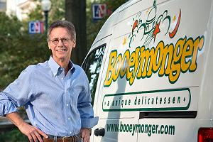 Photo of Ron Vogel next to Booeymonger van.