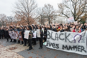 "An American University student-led demonstration was held on the steps of Mary Graydon Center. Signs included ""Stand with the People of Ferguson,"" and the popular ""Black Lives Matter."""