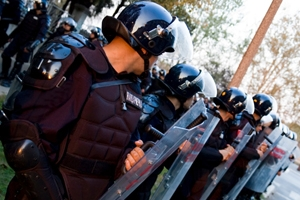Riot police enforce the line