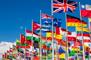 Flags of many different nations blowing in the wind