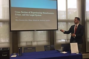 AU students present research findings on homelessness.