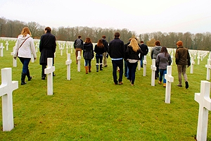 Students touring the Ardennes graveyard