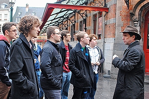 Students listening to a lecture by the director on a city tour
