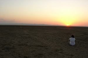 Student watching sunset at Lake Turkana