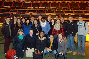 AU Students together on the field of the Real Madrid soccer stadium.