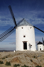A picture of a windmill in northern Spain with a blue sky background