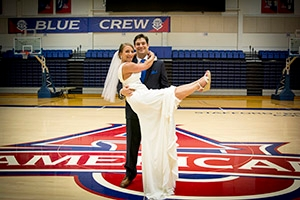 Lisa and Justin recreate their favorite cheerleading photo in Bender Arena on their wedding day.