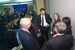 Mark Whitaker, center, talks with other panelists before the American Forum. (Photo: Jeff Watts)