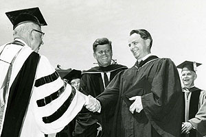 Photo: Robert Byrd is congratulated by AU President Hurst Anderson while President Kennedy looks on at AU's 1963 commencement.