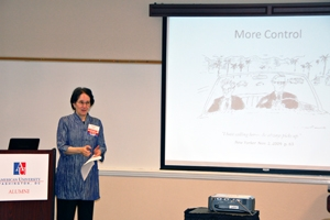 Linguistics professor discusses technology at a faculty down the road alumni event.