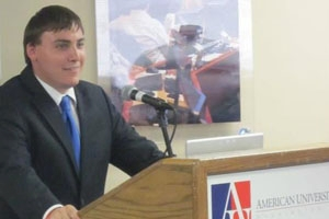 Elliot Bell-Krasner, SPA/MPP '12, addresses the crowd at an AU event.