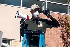 Man on a ladder with a megaphone
