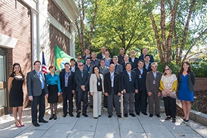 Executives from Brazil stand with Key staff members for a photo outside of the Spring Valley Building.