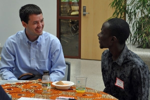 two SIS students - one Caucasian, one African-American - have a lively conversation at diversity breakfast