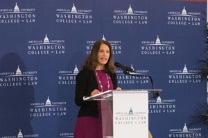 AU president Sylvia Burwell speaking at a lectern at the Washington College of Law.